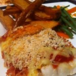 Spicy tomato and cheese topped cod